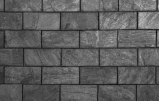 graues Fliesenbeschaffenheitshintergrundwandmuster foto