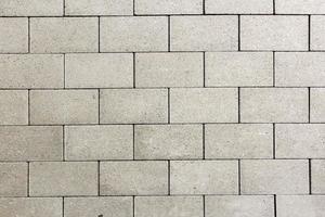 Detail der Fliesen auf der Straße gibt ein harmonisches Muster foto