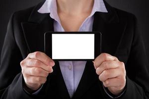 Unternehmer zeigt Handy foto
