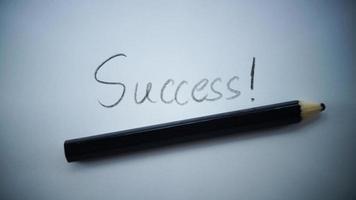 Erfolgswort mit Bleistift unterstrichen foto