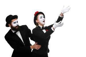 Pantomime hält einen anderen am Laufen foto