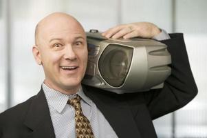 Geschäftsmann mit einer Boombox foto