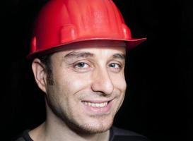 Arbeiterhut und lächelnde Sicherheit foto