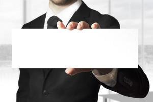 Geschäftsmann hält Zeichen leer foto