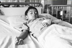 der Patient auf dem Bett foto