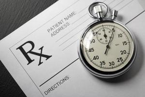 leere Patientenliste und Stoppuhr foto