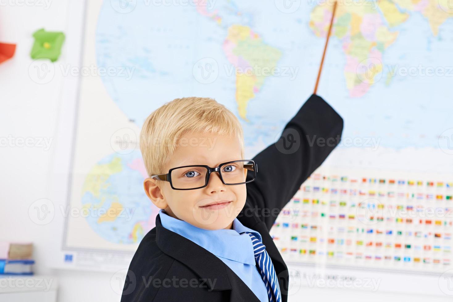 liten lärare i geografi foto