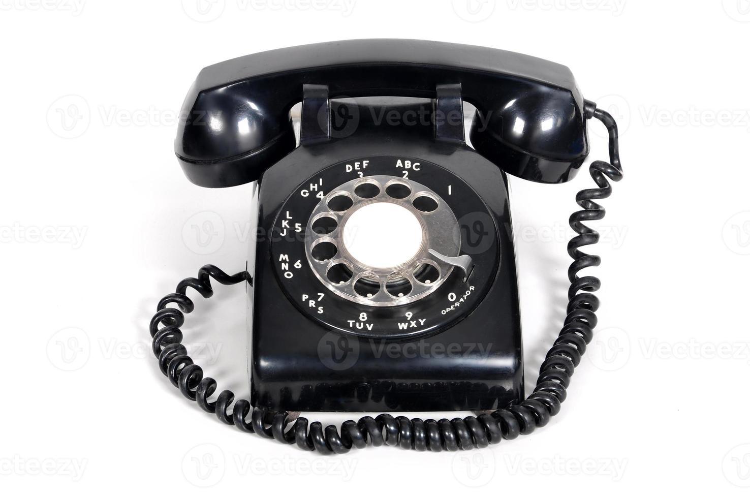 isolerad vintage telefon på vit bakgrund foto