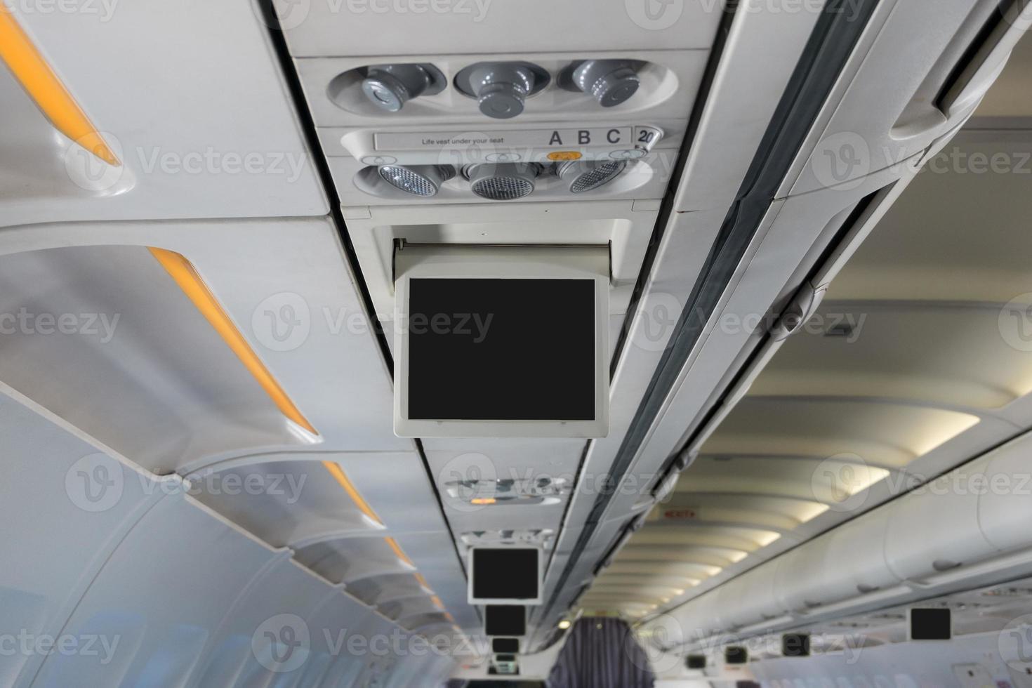 övervaka över huvudet i flygplan foto