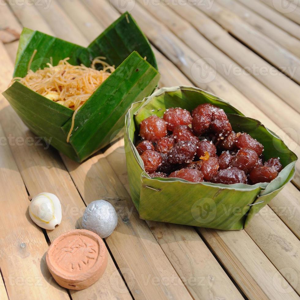 Thailand traditionell, söt matefterrätt och forntida mynt på foto