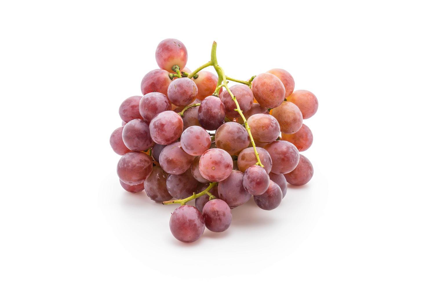färska druvor på vit bakgrund foto