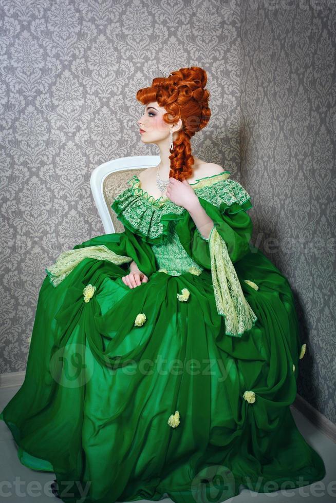 prinsessa i magnifik grön klänning foto