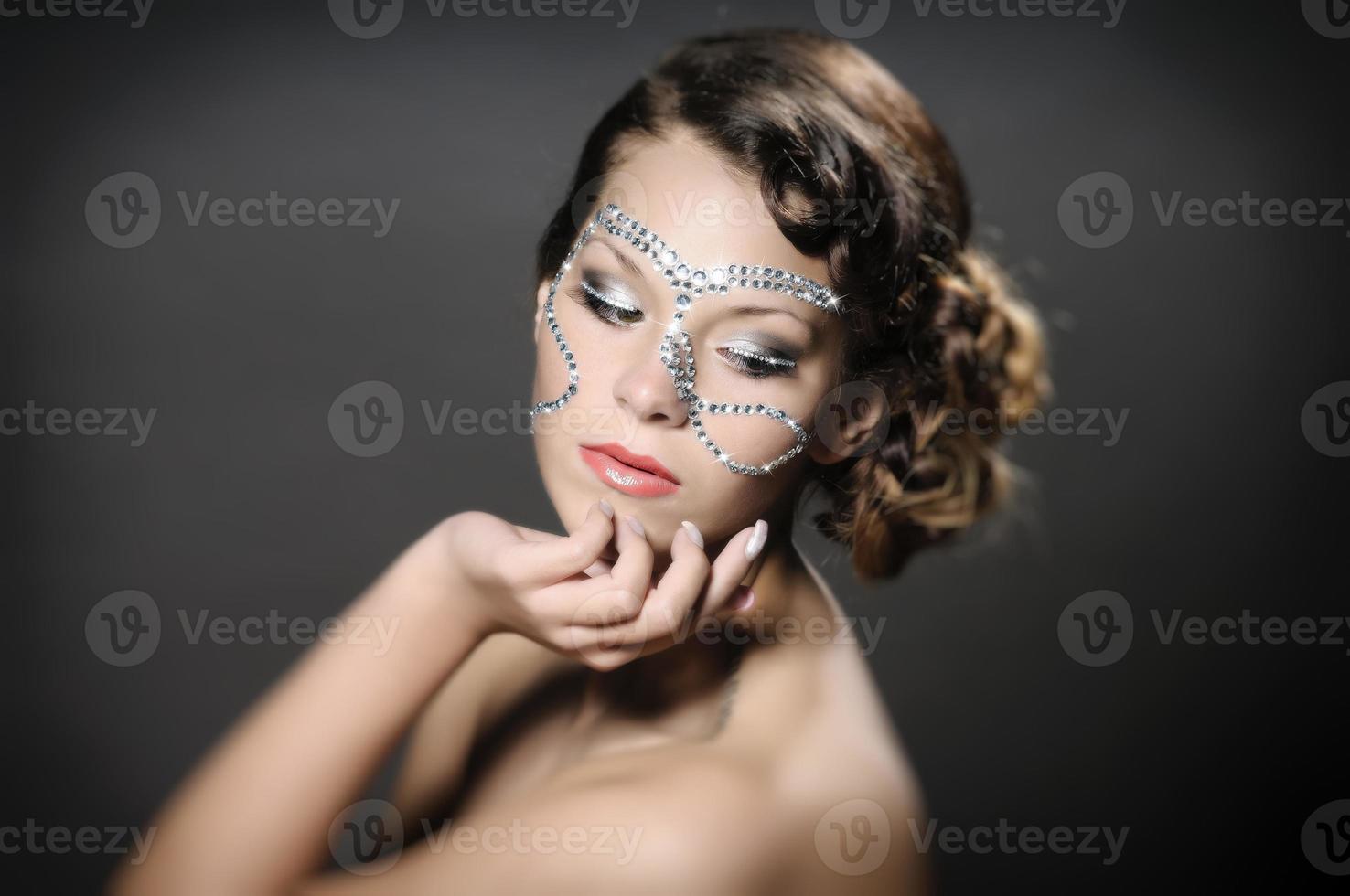 flicka med diamant smink foto