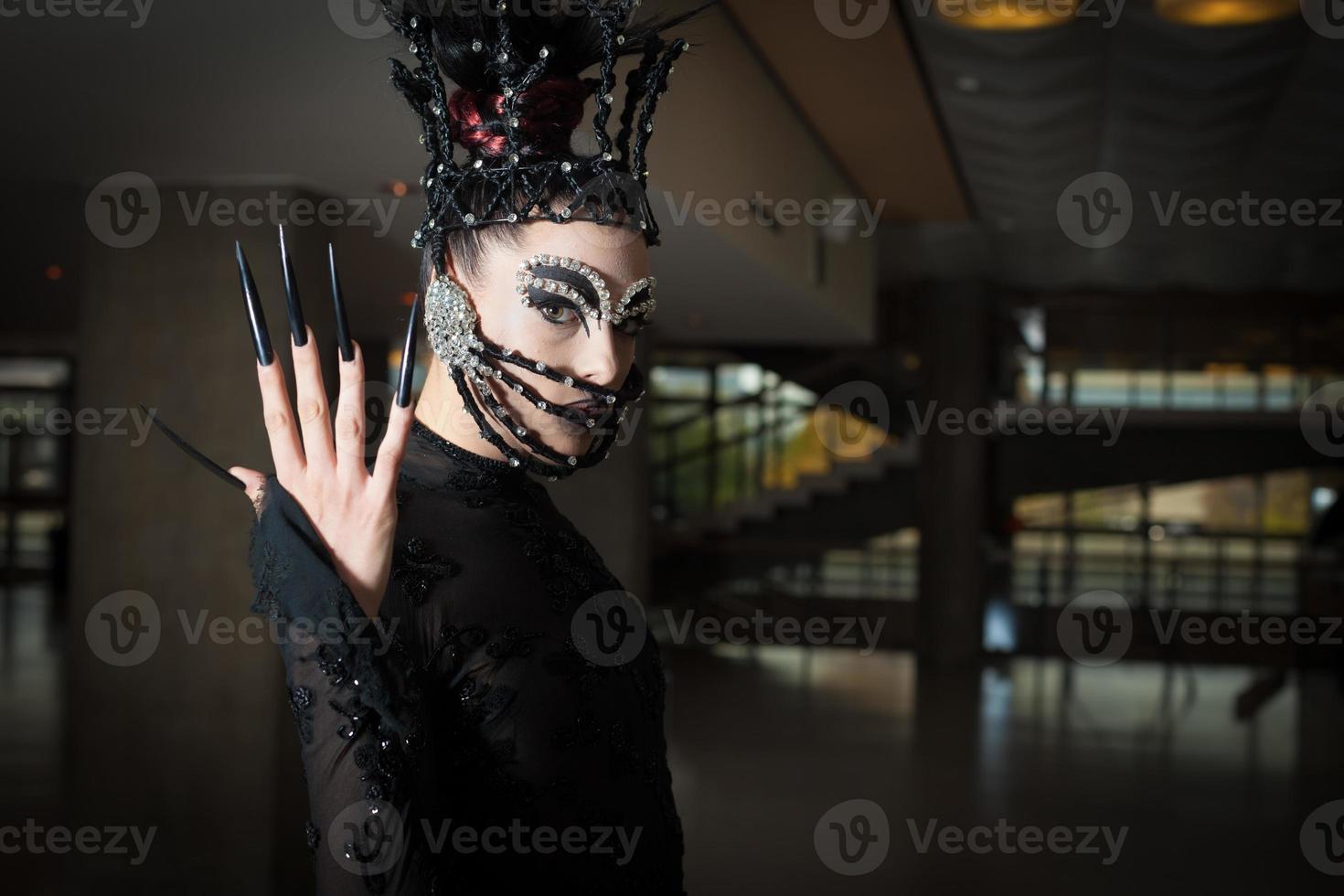 kvinna med modeutrustning foto