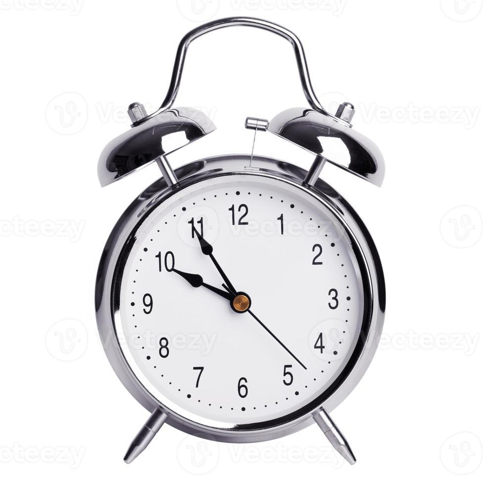 fem minuter till tio på en väckarklocka foto