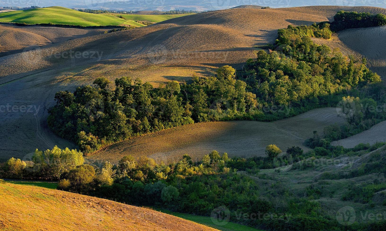 Toscana - landskapspanorama, kullar och äng, Toscana - Italien foto