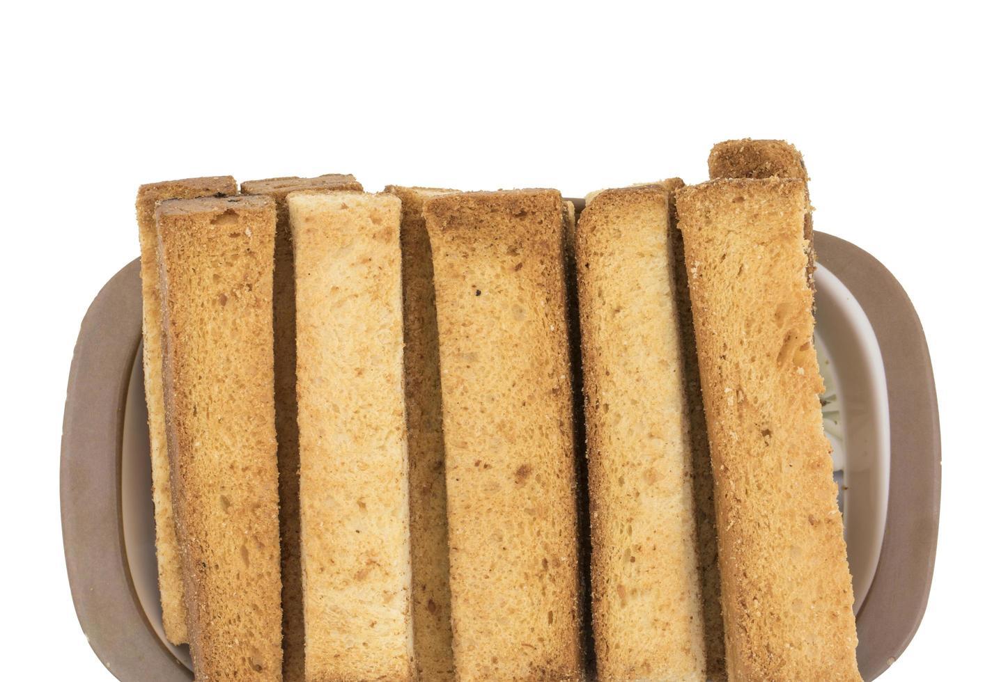 närbild av rostat bröd på en tallrik foto