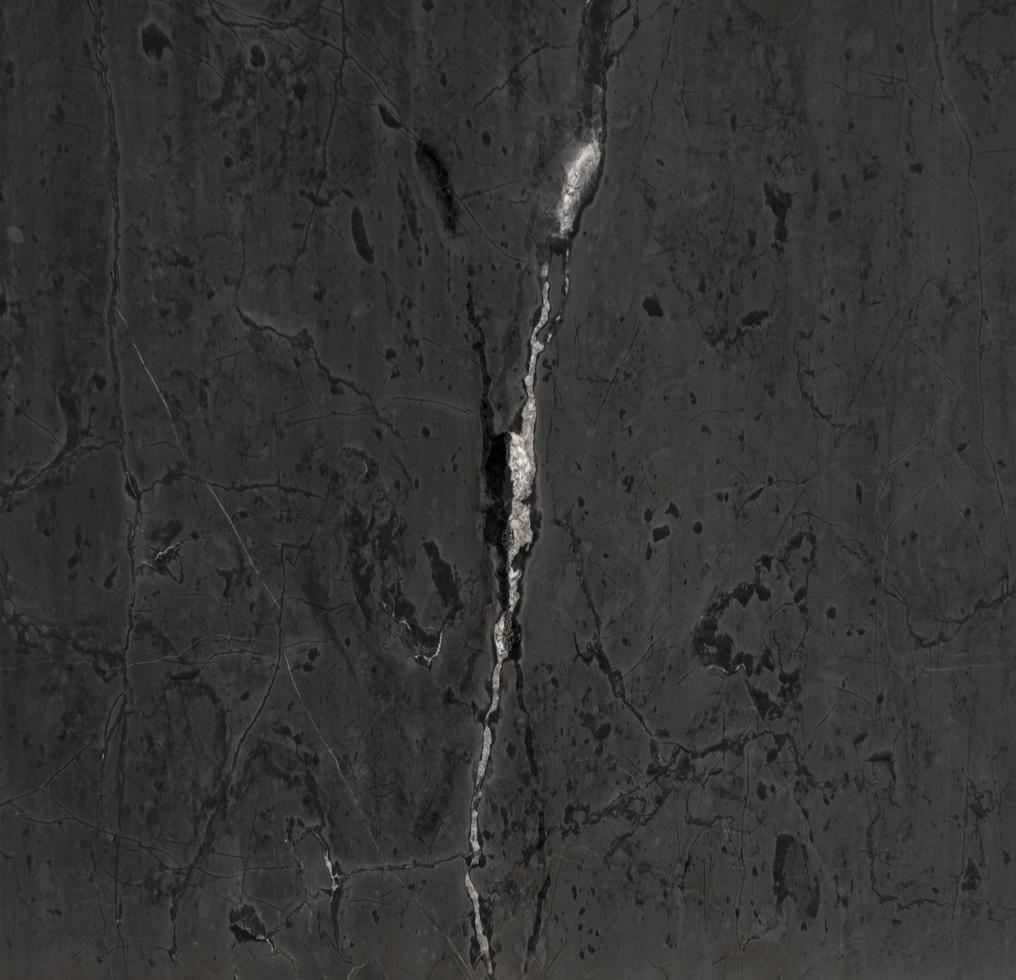 vit strimma i svart sten textur bakgrund foto