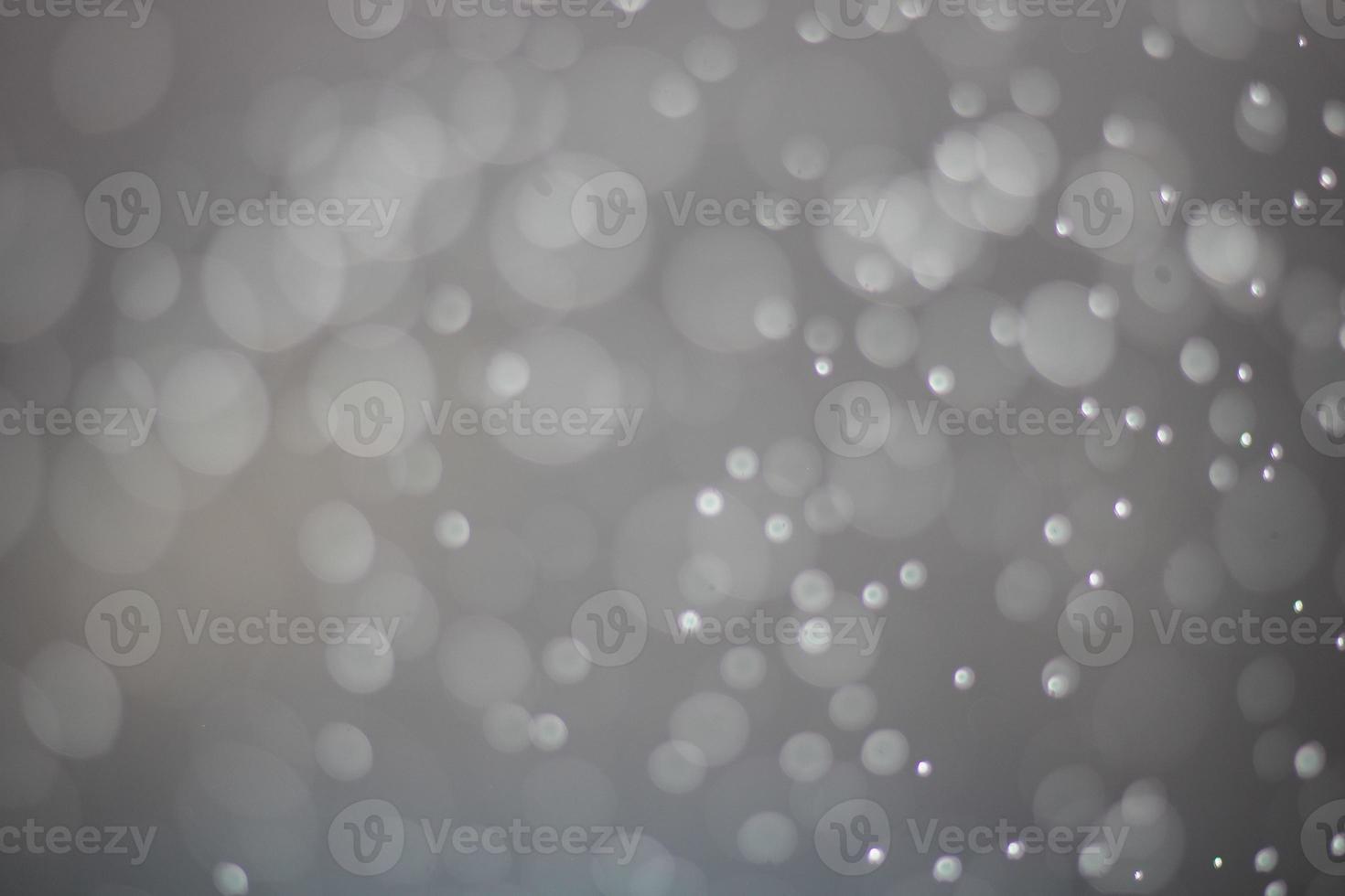 oskärpa vit och grå mousserande och bokeh bakgrund foto