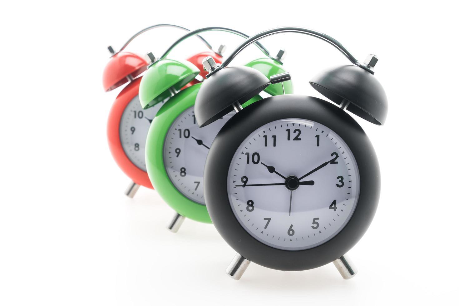 väckarklockor på vit bakgrund foto