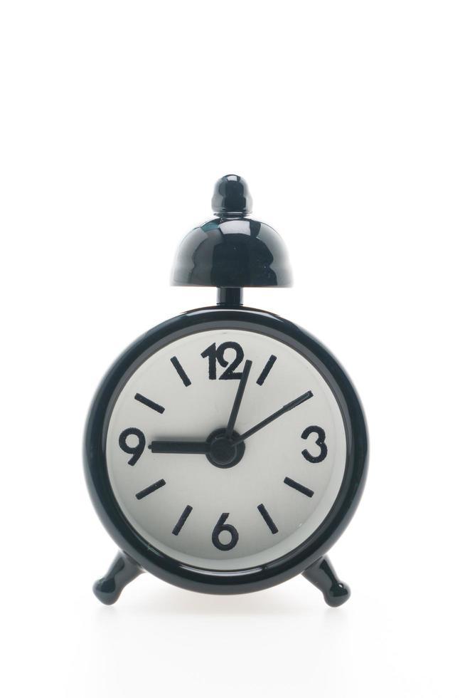 väckarklocka på på vit bakgrund foto