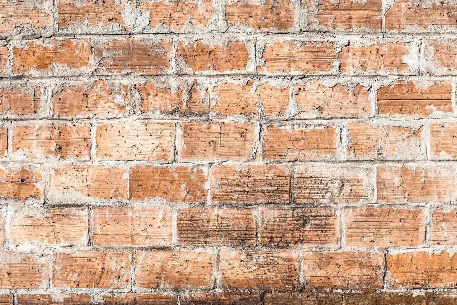 gammal väderbitna tegelvägg foto
