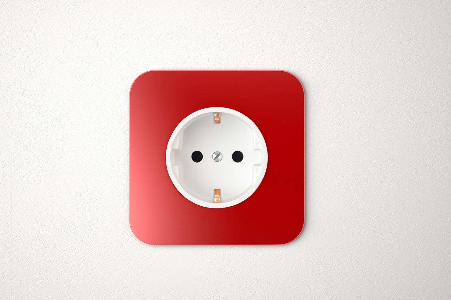 rött eluttag på den vita väggen foto