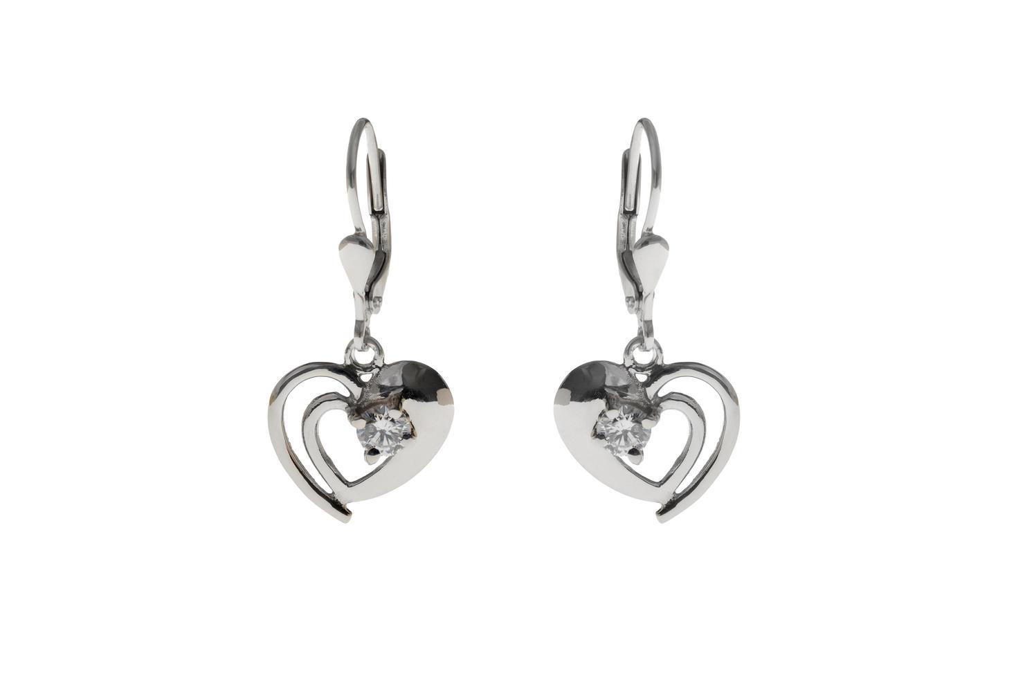silverörhängen i form av hjärta foto