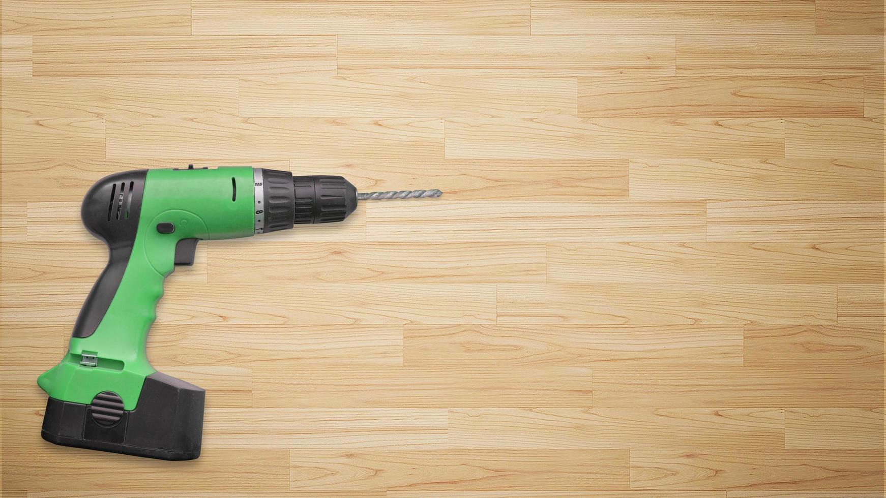 borrmaskin på träbakgrund foto