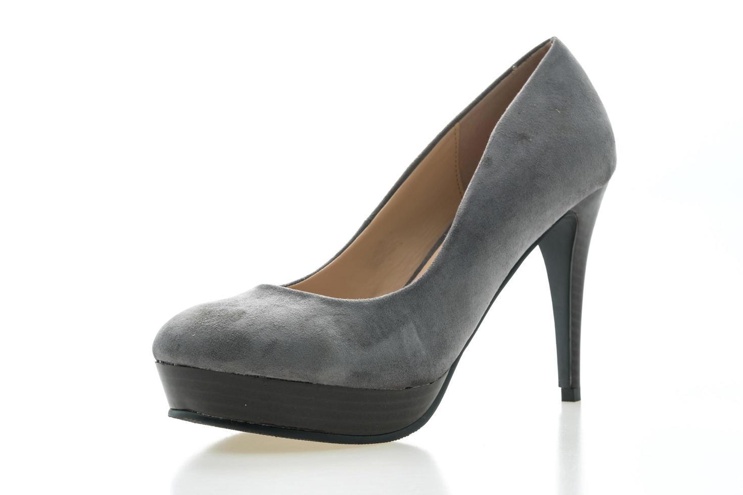 högklackad sko på vit bakgrund foto