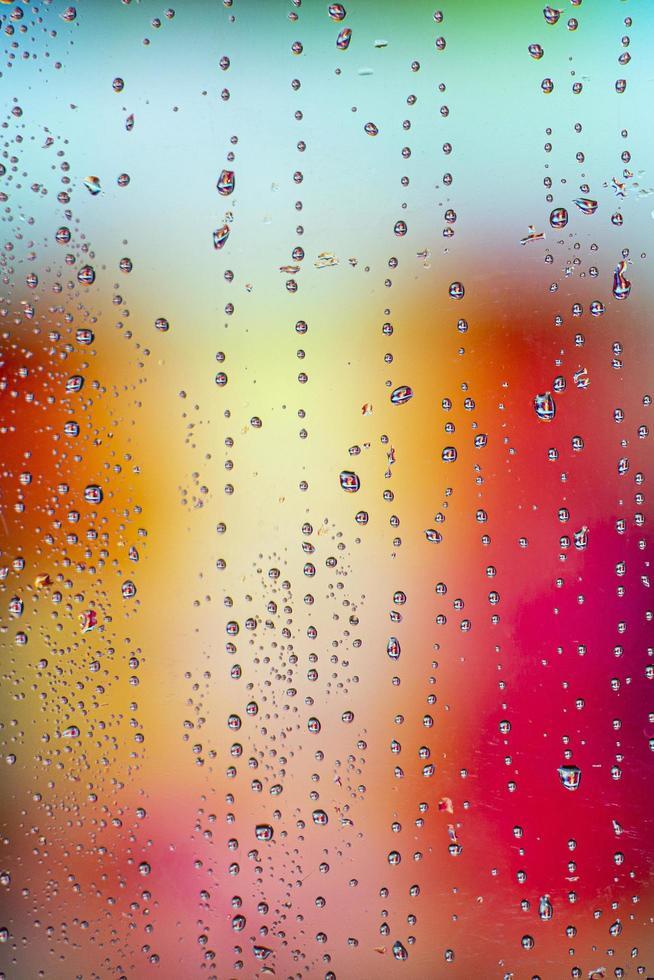 bakgrund regndroppar med bokeh foto
