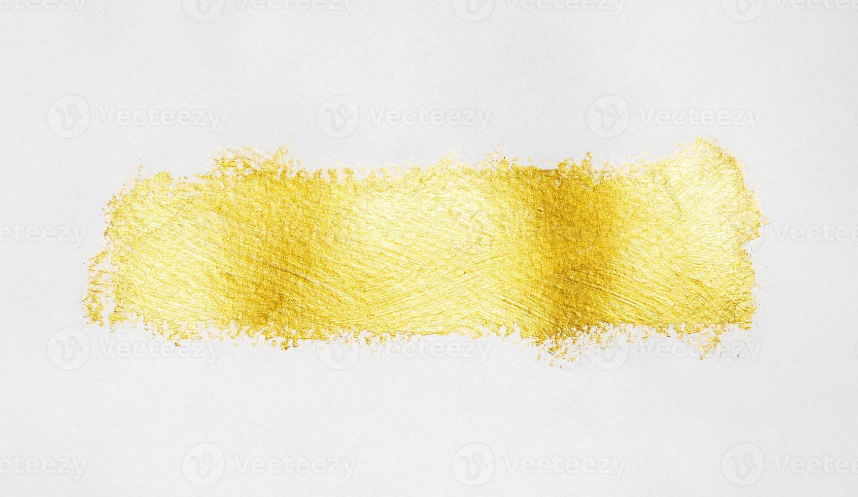 isolerad penseldrag av guldfärg foto