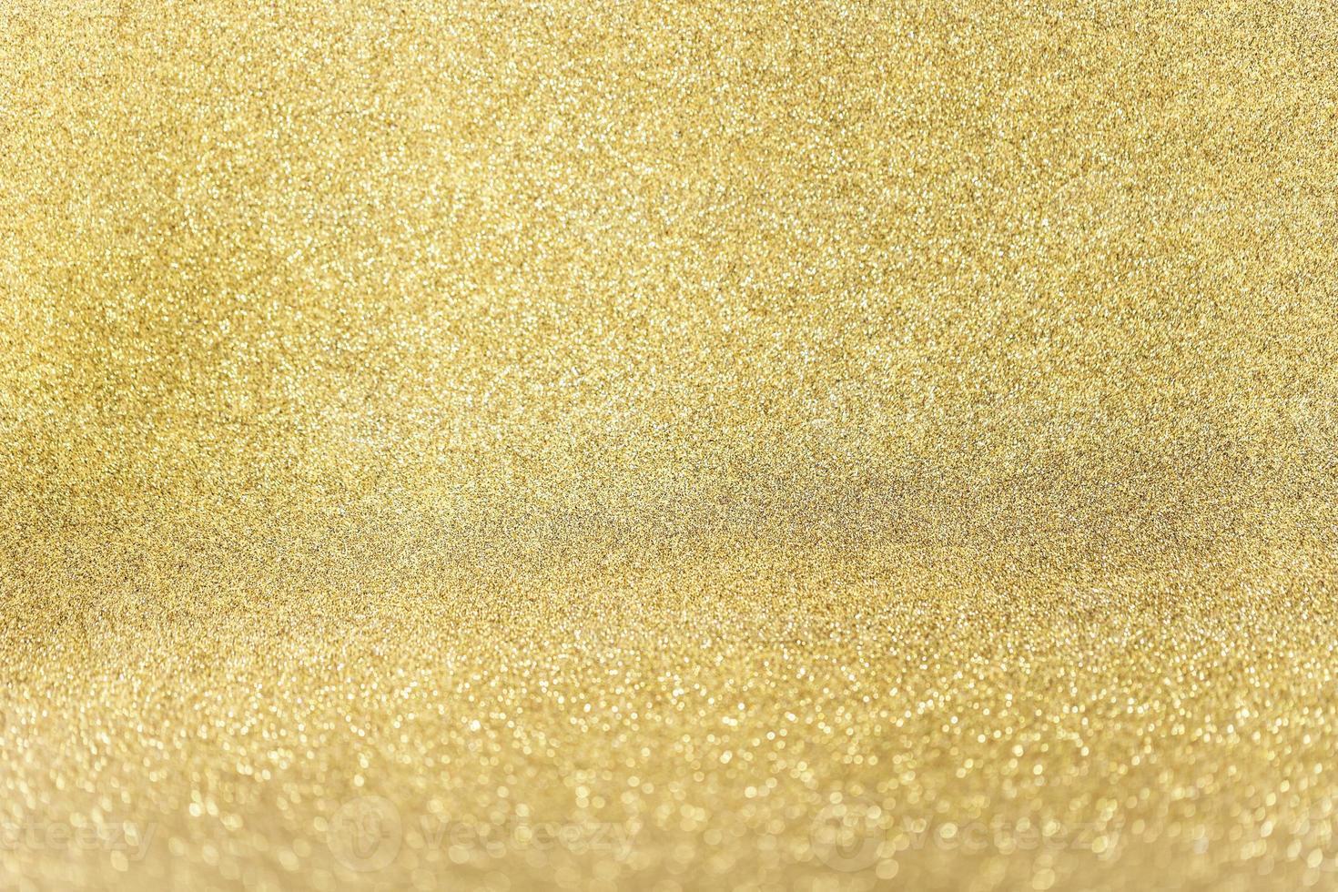 närbild gyllene glitter bakgrund foto
