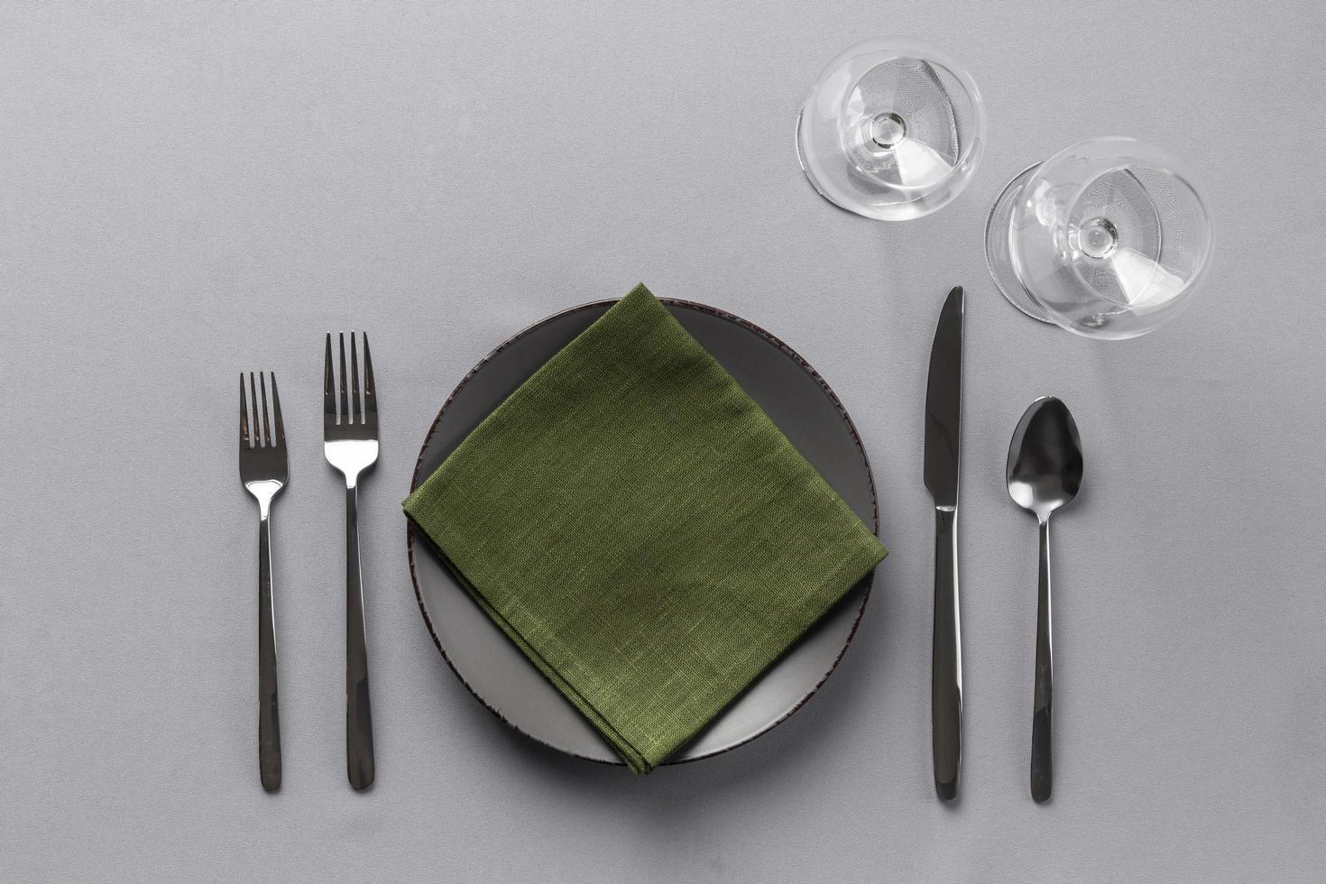 dukning med grön servett foto