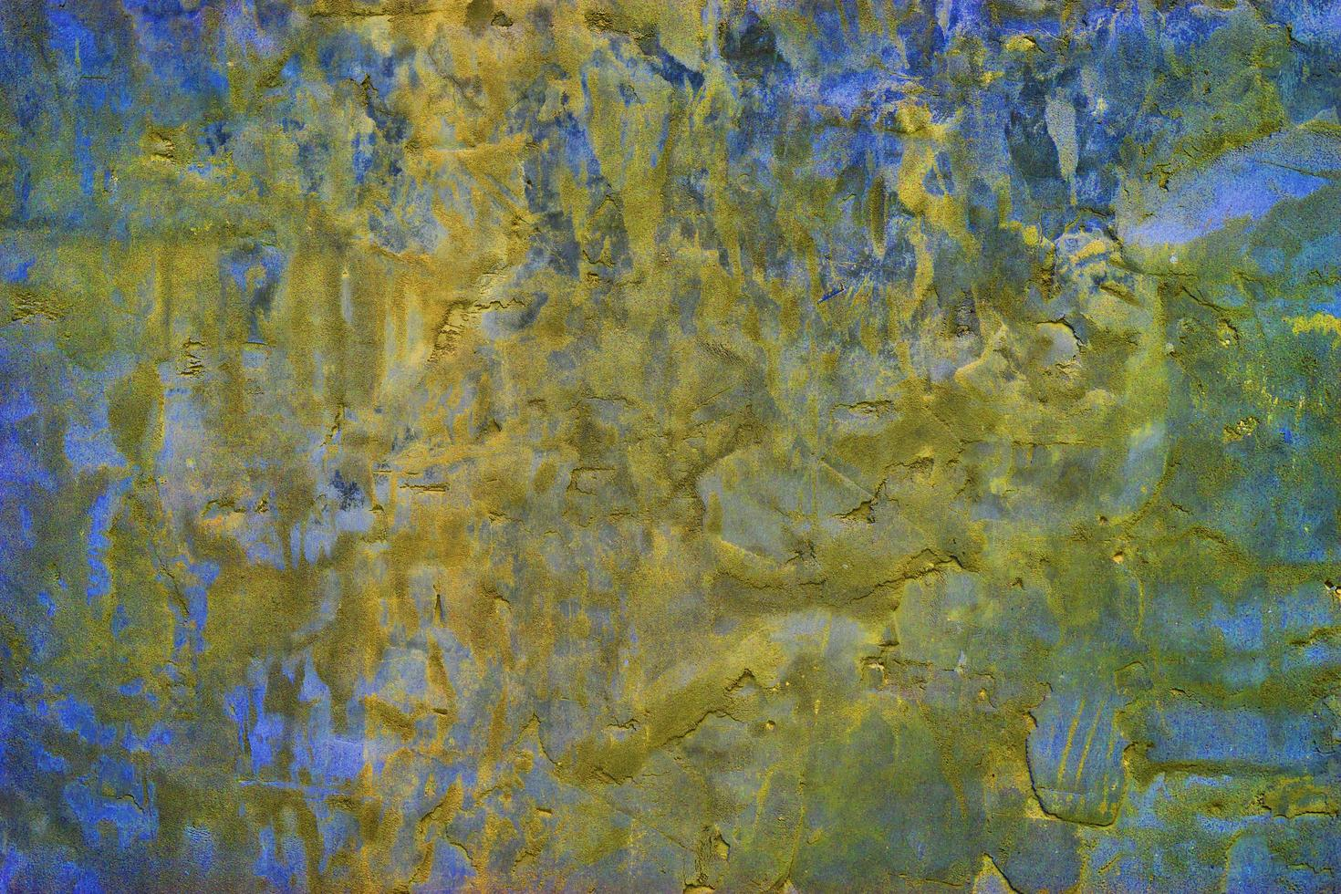 betongbakgrund i blå-gul färg med stor konsistens. foto