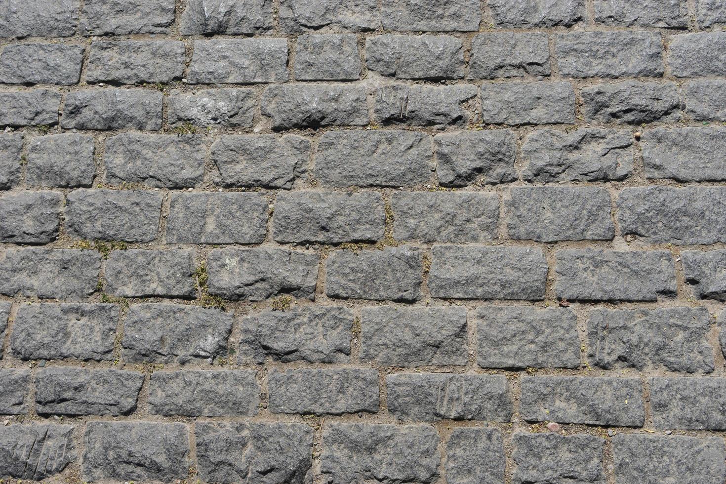 grå tegelvägg bakgrund för design foto