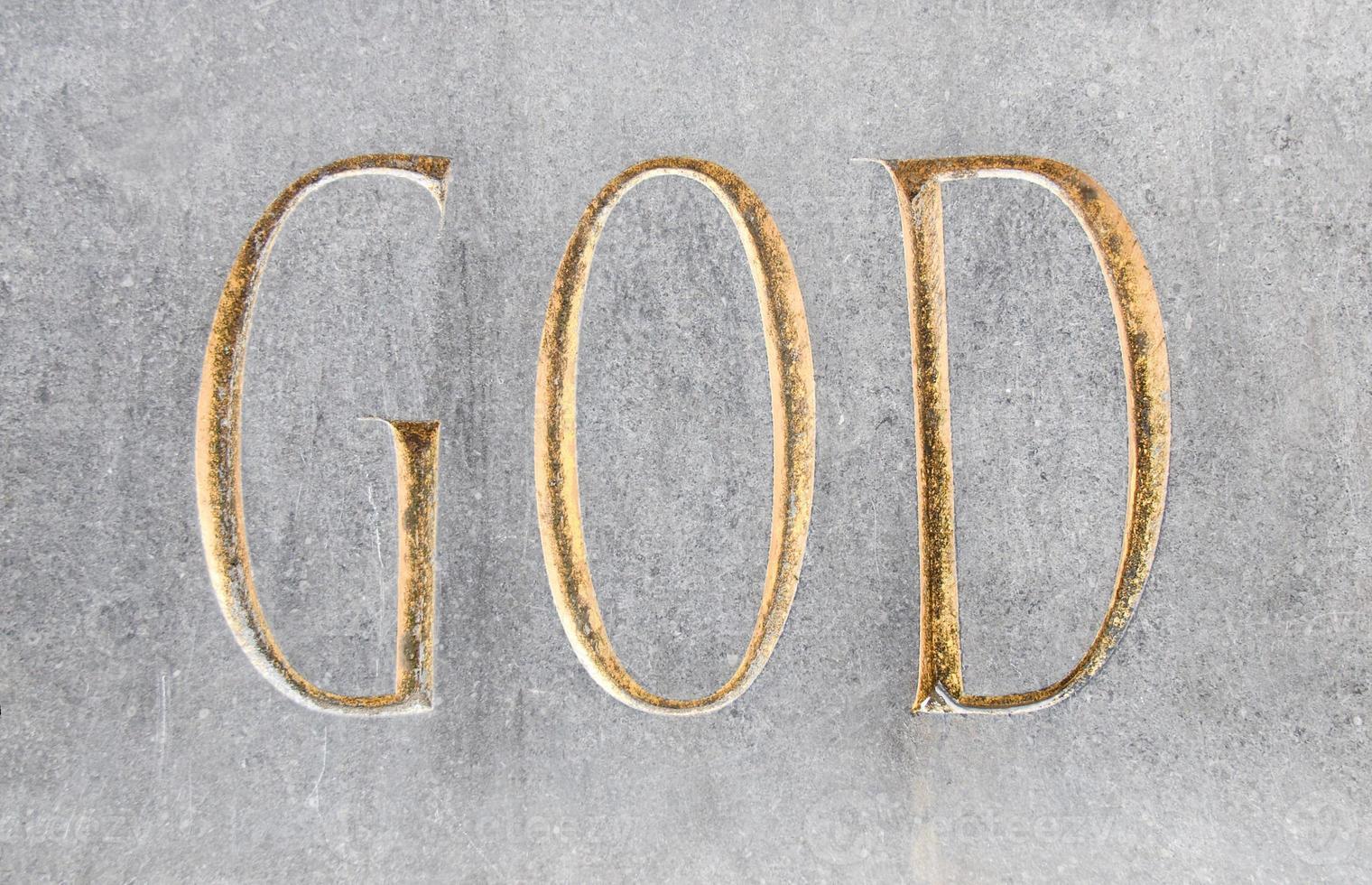gudens inskrift i sten foto