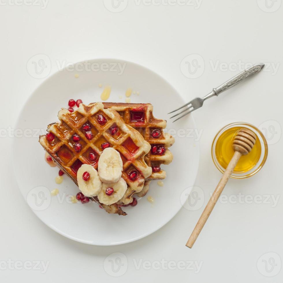 våffla med honungsgaffel foto