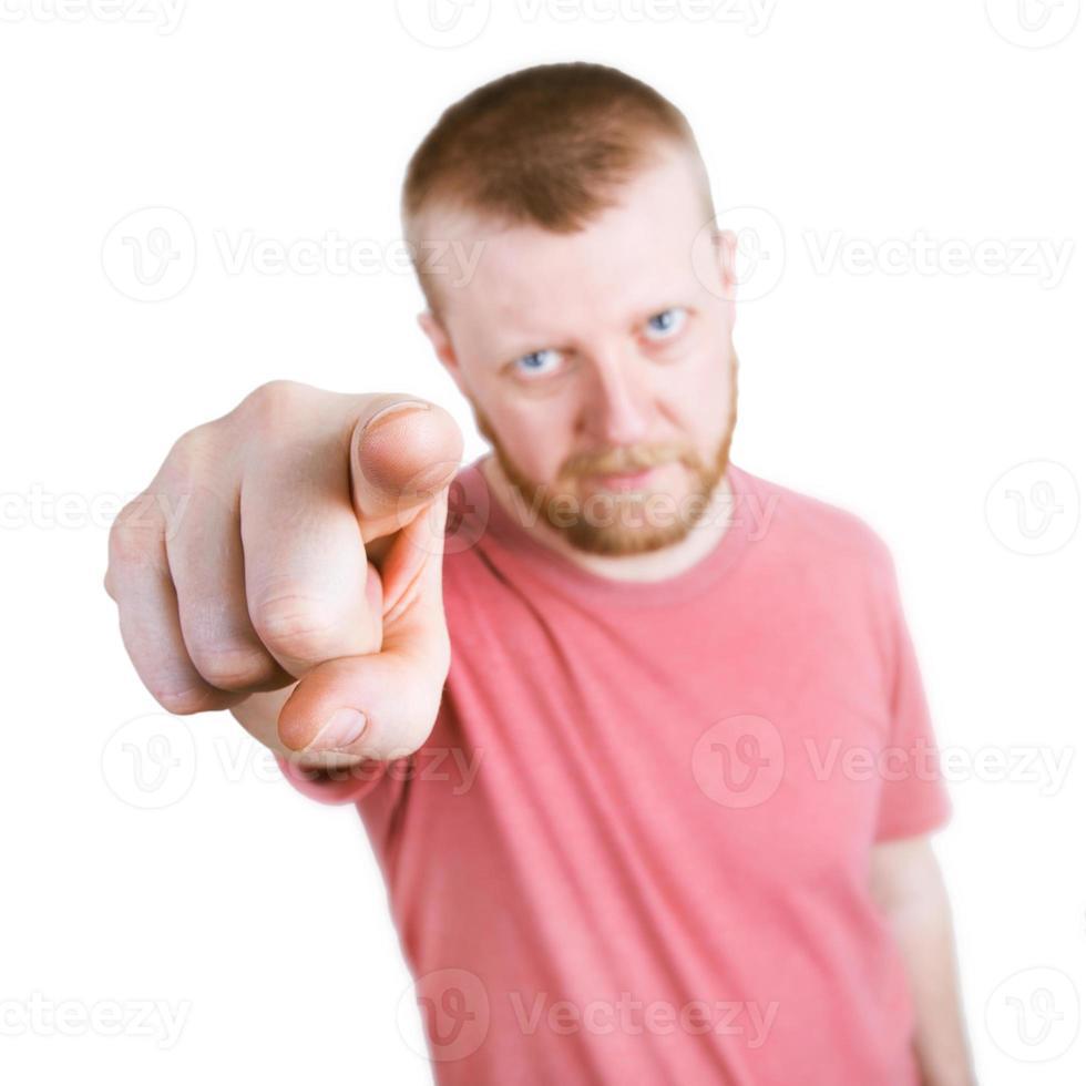 mannen pekar pekfingret mot kameran foto