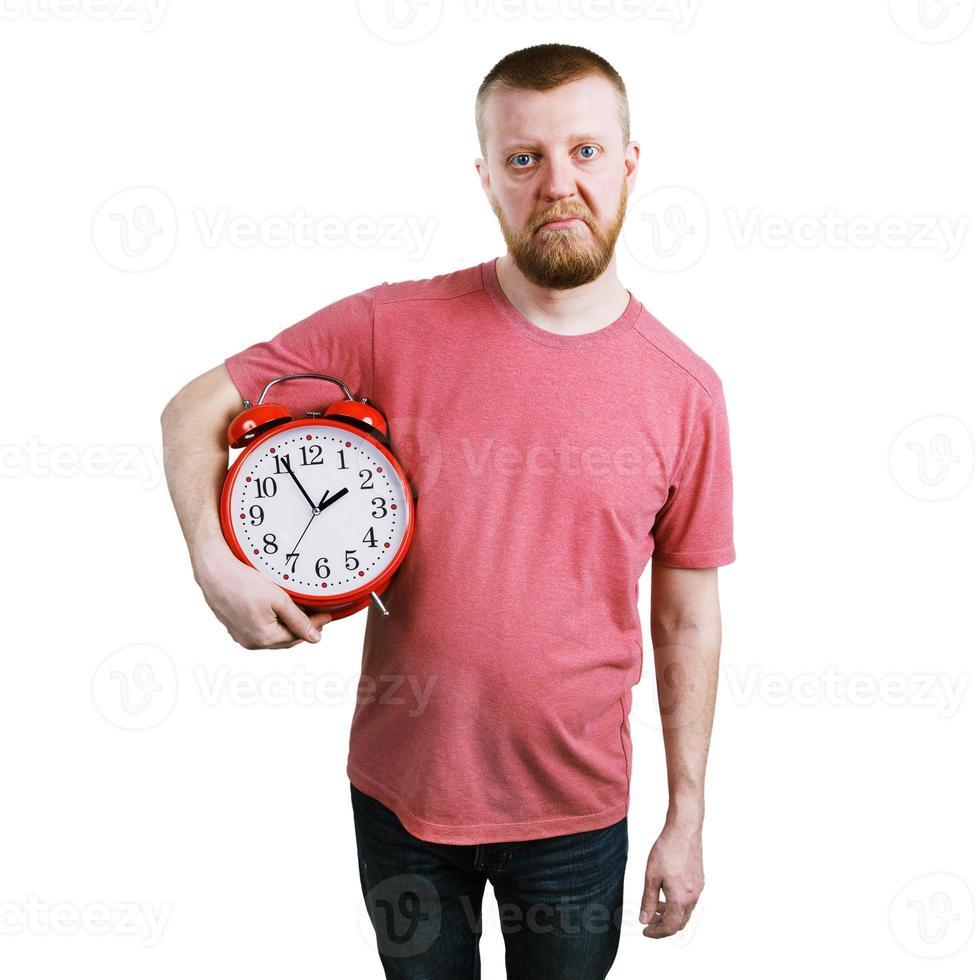 olycklig man med en väckarklocka foto