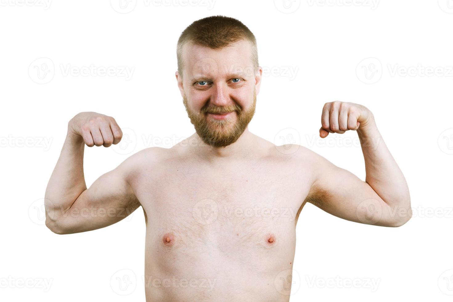 rolig skäggig man visar sina biceps foto
