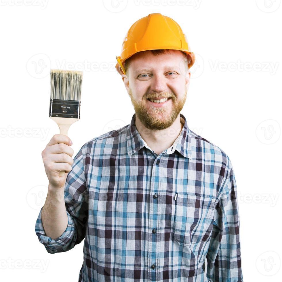 man i en orange hjälm med en pensel foto
