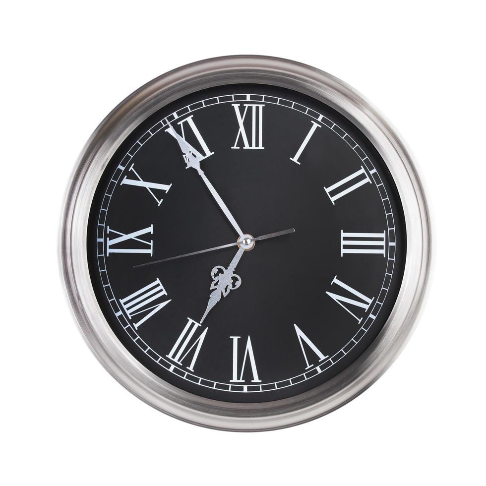 fem minuter till sju på en klocka foto