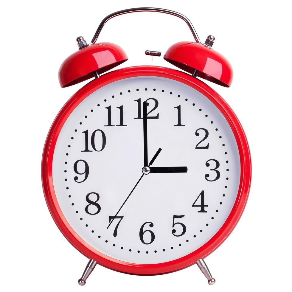 röd väckarklocka visar exakt tre timmar foto