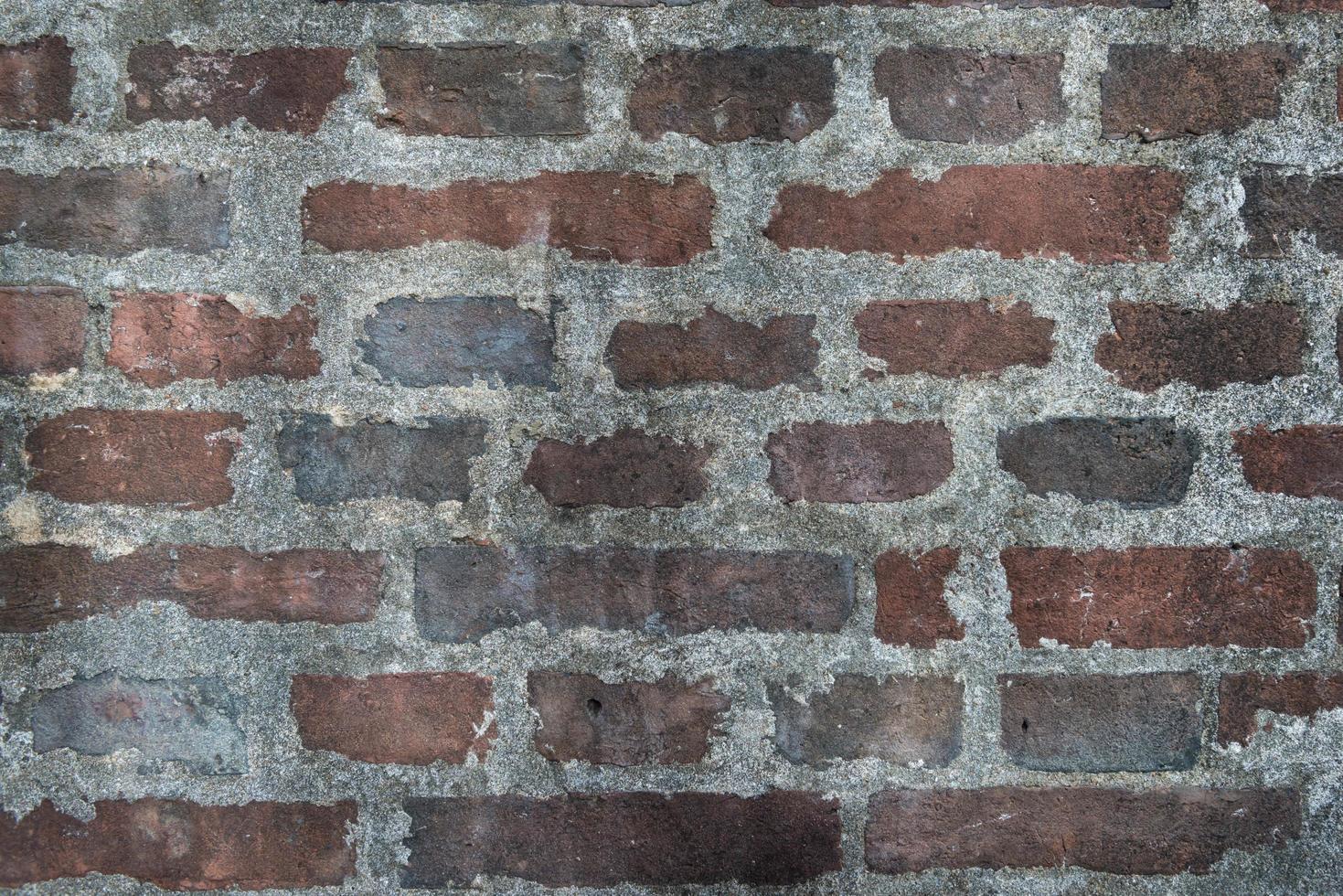 brun tegelvägg med cementstruktur bakgrund loftstil foto
