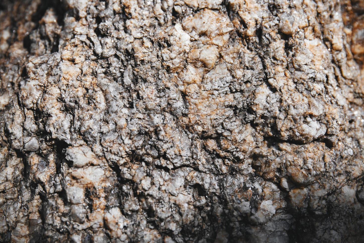 sten texturerad närbild med glitter liten bit på ytan. foto