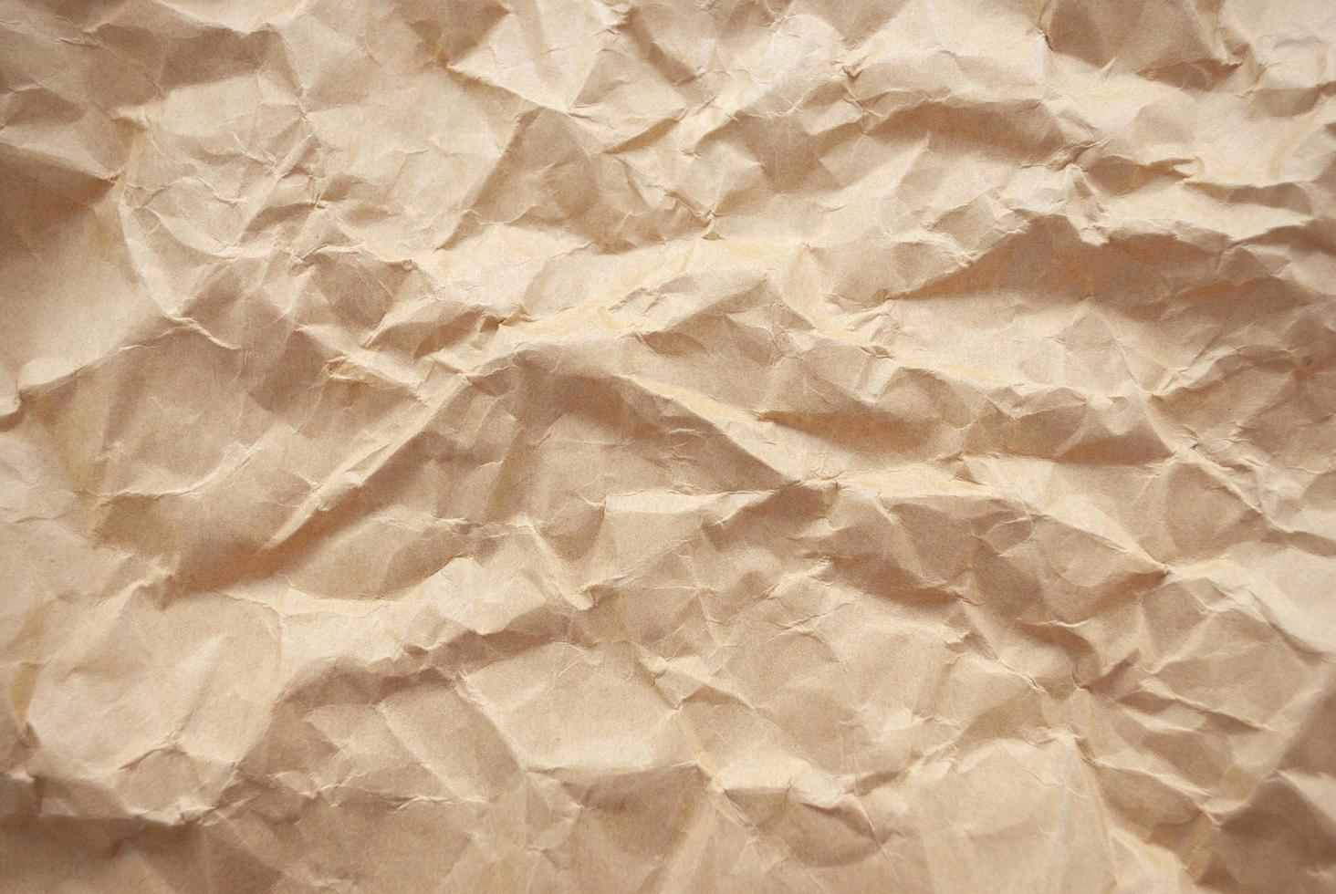 skrynkligt brunt papper textur och bakgrund foto