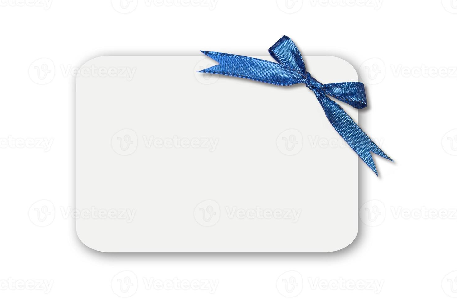 rosett på ett vitt tomt presentkort foto