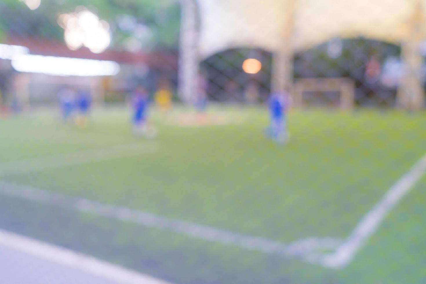 abstrakt suddig fotbollsplan foto