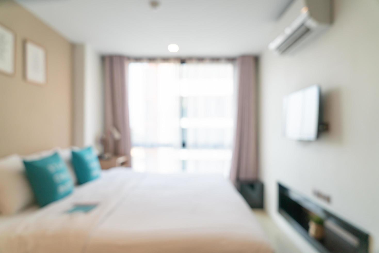 abstrakt oskärpa säng i sovrum för bakgrund foto